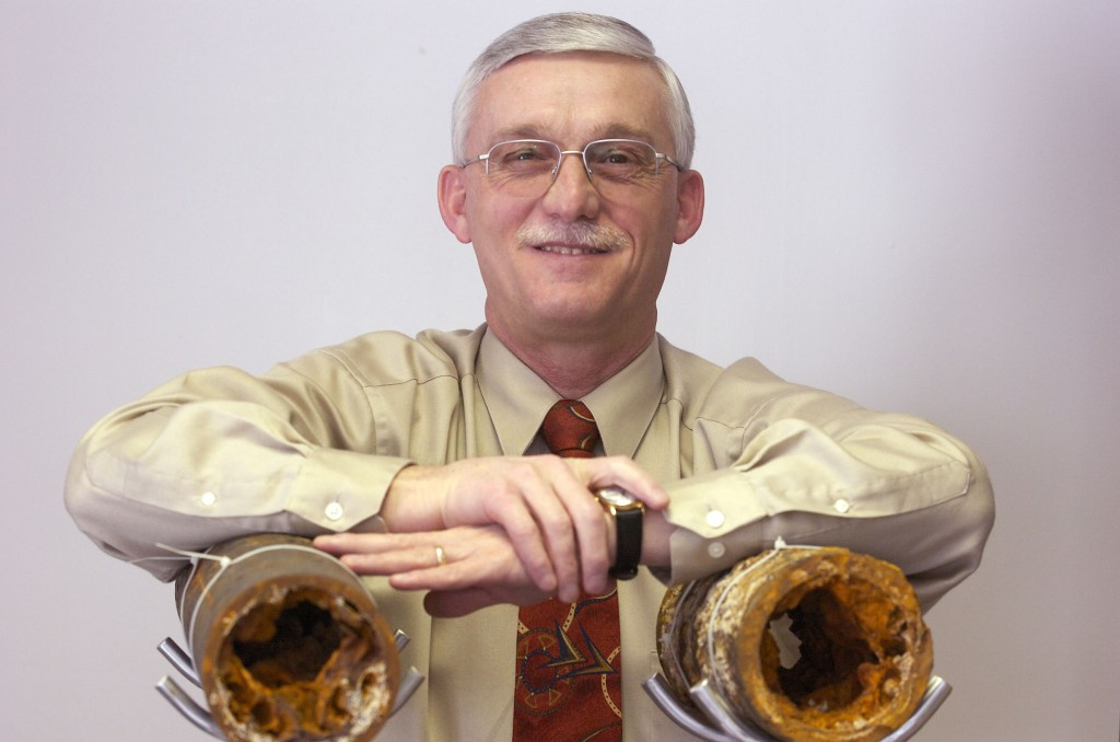 Henderson Water Utility manager Bruce Shipley with examples of 12o year old water pipes showing a mineral depost called tuberculation.  (Gleaner photo by Mike Lawrence * 831-8346 or mlawrence@thegleaner.com)  02/24/2006